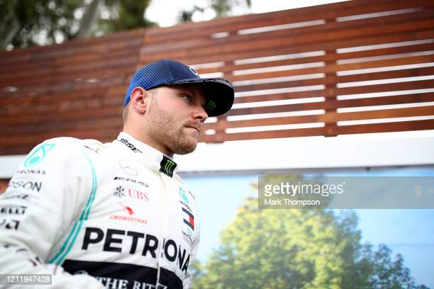 Valtteri Bottas of Finland and Mercedes GP looks on as he walks through the paddock during previews ahead of the F1 Grand Prix of Australia at...
