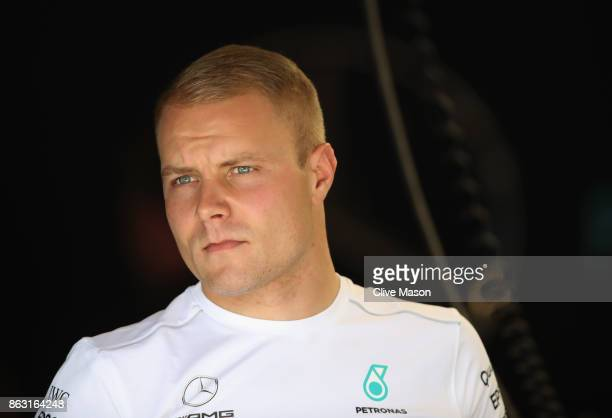 Valtteri Bottas of Finland and Mercedes GP looks on in the garage during previews ahead of the United States Formula One Grand Prix at Circuit of The...