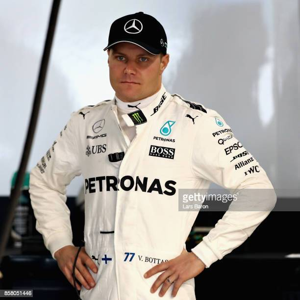 Valtteri Bottas of Finland and Mercedes GP prepares to drive in the garage during practice for the Formula One Grand Prix of Japan at Suzuka Circuit...
