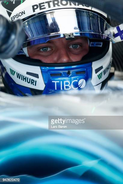 Valtteri Bottas of Finland and Mercedes GP prepares to drive in the garage during practice for the Bahrain Formula One Grand Prix at Bahrain...