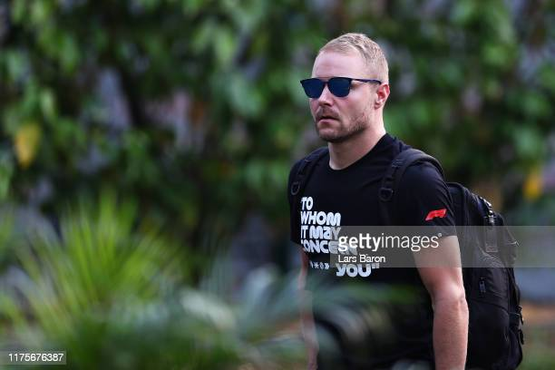 Valtteri Bottas of Finland and Mercedes GP walks in the Paddock during previews ahead of the F1 Grand Prix of Singapore at Marina Bay Street Circuit...