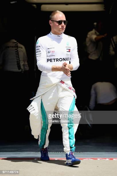Valtteri Bottas of Finland and Mercedes GP walks in the Pitlane before the Canadian Formula One Grand Prix at Circuit Gilles Villeneuve on June 10...