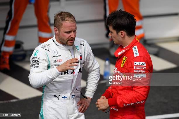Valtteri Bottas of Finland and MercedesAMG Petronas Motorsport and Charles Leclerc of Monaco and Scuderia Ferrari Mission Winnow during the Pirelli...