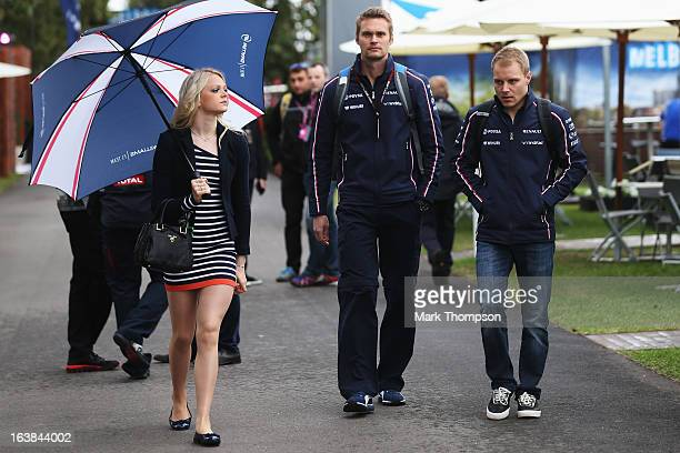 Valtteri Bottas of Finland and Williams and his girlfriend Emilia Pikkarainen arrive in the paddock before the weather delayed qualifying session for...
