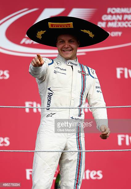 Valtteri Bottas of Finland and Williams celebrates on the podium after finishing third in the Formula One Grand Prix of Mexico at Autodromo Hermanos...