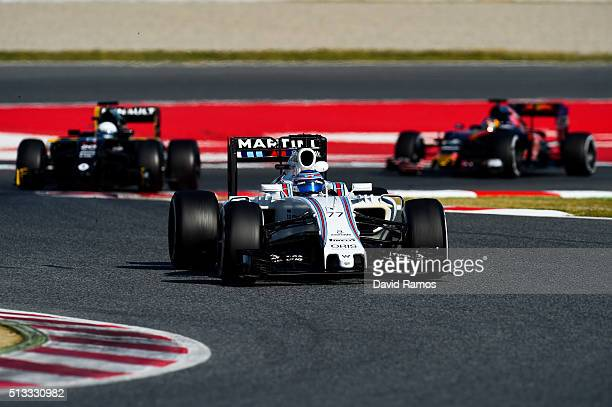 Valtteri Bottas of Finland and Williams drives ahead of Kevin Magnussen of Denmark and Renault Sport and Carlos Sainz of Spain and Scuderia Toro...