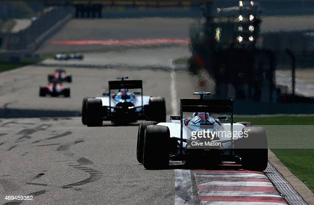 Valtteri Bottas of Finland and Williams drives behind Felipe Massa of Brazil and Williams during the Formula One Grand Prix of China at Shanghai...