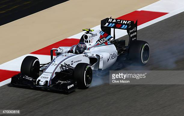 Valtteri Bottas of Finland and Williams locks his brakes during practice for the Bahrain Formula One Grand Prix at Bahrain International Circuit on...