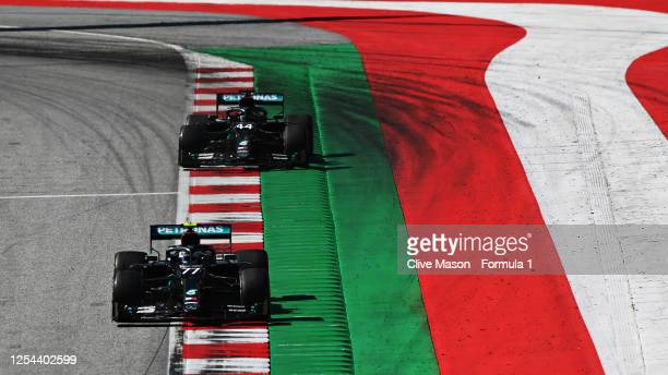 Valtteri Bottas of Finland driving the Mercedes AMG Petronas F1 Team Mercedes W11 leads Lewis Hamilton of Great Britain driving the Mercedes AMG...