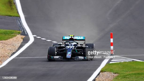 Valtteri Bottas of Finland driving the Mercedes AMG Petronas F1 Team Mercedes W11 into the pitlane with a puncture during the F1 Grand Prix of Great...