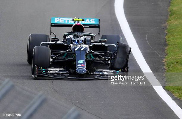 Valtteri Bottas of Finland driving the Mercedes AMG Petronas F1 Team Mercedes W11 with a punctured front left tyre during the F1 Grand Prix of Great...