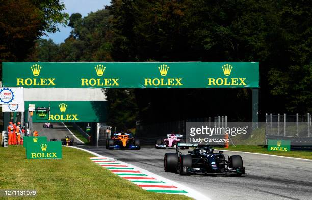 Valtteri Bottas of Finland driving the Mercedes AMG Petronas F1 Team Mercedes W11 leads Carlos Sainz of Spain driving the McLaren F1 Team MCL35...