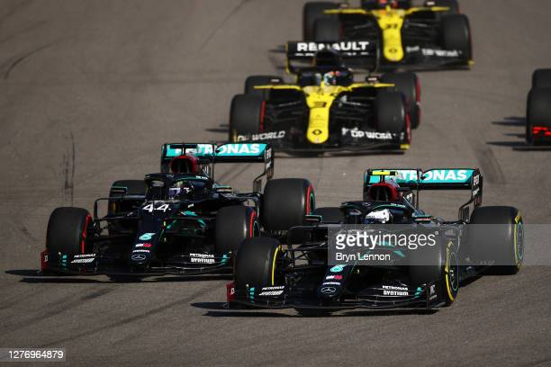 Valtteri Bottas of Finland driving the Mercedes AMG Petronas F1 Team Mercedes W11 and Lewis Hamilton of Great Britain driving the Mercedes AMG...