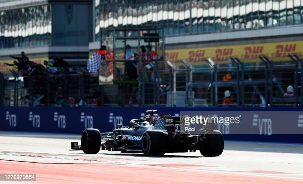 Valtteri Bottas of Finland driving the Mercedes AMG Petronas F1 Team Mercedes W11 takes the flag at the finish during the F1 Grand Prix of Russia at...