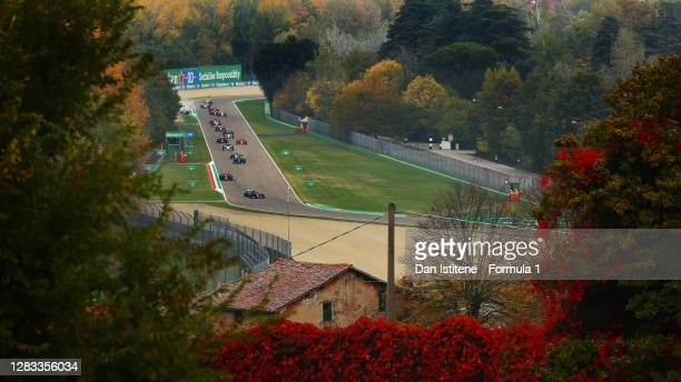 Valtteri Bottas of Finland driving the Mercedes AMG Petronas F1 Team Mercedes W11 leads Max Verstappen of the Netherlands driving the Aston Martin...