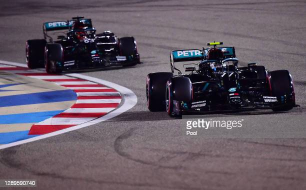 Valtteri Bottas of Finland driving the Mercedes AMG Petronas F1 Team Mercedes W11 leads George Russell of Great Britain driving the Mercedes AMG...