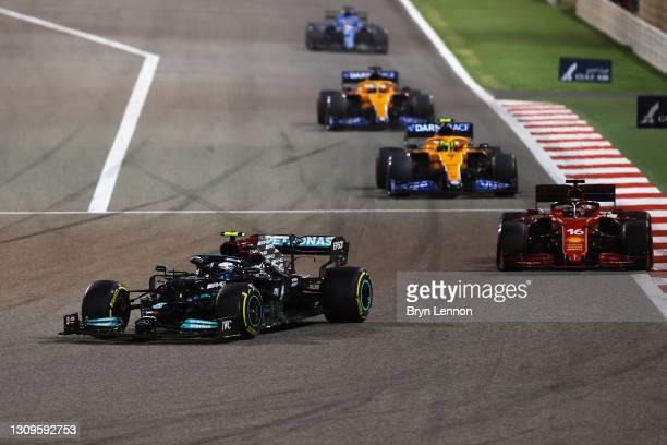 Valtteri Bottas of Finland driving the Mercedes AMG Petronas F1 Team Mercedes W12 leads Charles Leclerc of Monaco driving the Scuderia Ferrari SF21...