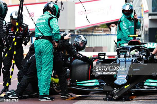 Valtteri Bottas of Finland driving the Mercedes AMG Petronas F1 Team Mercedes W12 makes a pitstop but his front right wheel is stuck on his car...
