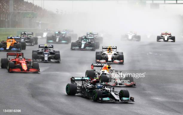 Valtteri Bottas of Finland driving the Mercedes AMG Petronas F1 Team Mercedes W12 leads Max Verstappen of the Netherlands driving the Red Bull Racing...