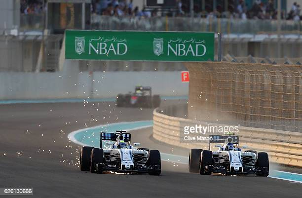 Valtteri Bottas of Finland driving the Williams Martini Racing Williams FW38 Mercedes PU106C Hybrid turbo and Felipe Massa of Brazil driving the...