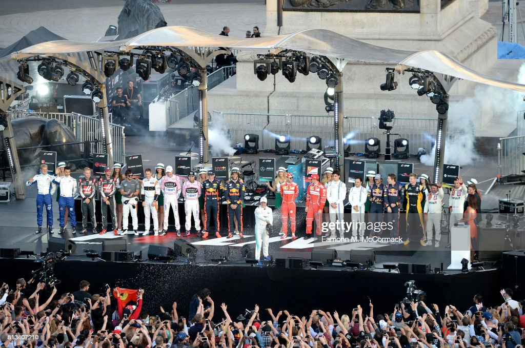 Valtteri Bottas sprays champagne on stage with drivers at the F1 Live in London event at Trafalgar Square on July 12, 2017 in London, England. F1 Live London, the first time in Formula 1 history that all 10 teams come together outside of a race weekend to put on a show for the public in the heart of London.