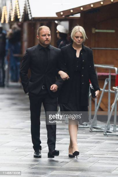 Valtteri Bottas with his partner Emilia Pikkarainen arrive at Niki Lauda's funeral ceremony at St Stephen's cathedral Vienna Austria on 29 May 2019...