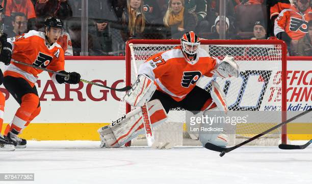 Valtteri Filppula and Brian Elliott of the Philadelphia Flyers prepare to stop a shot on goal against the Minnesota Wild on November 11 2017 at the...