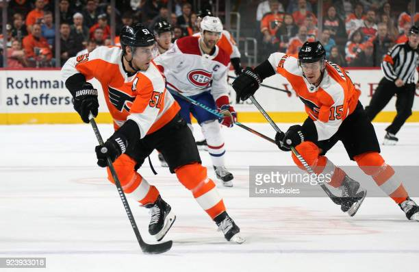 Valtteri Filppula and Jori Lehtera of the Philadelphia Flyers skate against the Montreal Canadiens on February 20 2018 at the Wells Fargo Center in...