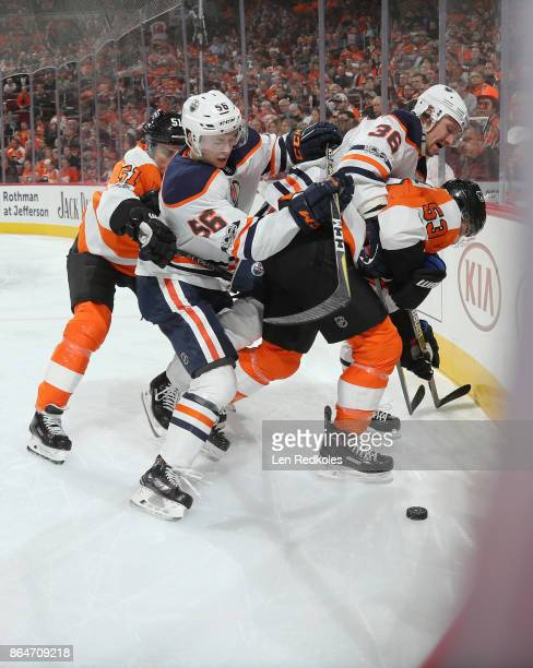 Valtteri Filppula and Shayne Gostisbehere of the Philadelphia Flyers battle for the loose puck in the corner with Kailer Yamamoto and Jussi Jokinen...