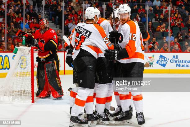 Valtteri Filppula Michael Raffl and teammates of the Philadelphia Flyers celebrate in a game against the Philadelphia Flyers at the Scotiabank...