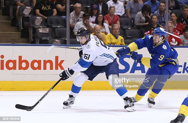 Valtteri Filppula of Team Finland stickhandles the puck with pressure from Filip Forsberg of Team Sweden during the World Cup of Hockey 2016 at Air...