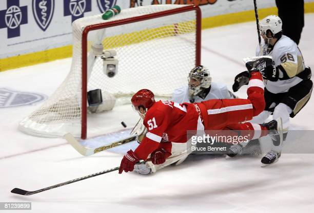 Valtteri Filppula of the Detroit Red Wings scores a diving third period goal past goaltender MarcAndre Fleury of the Pittsburgh Penguins during game...