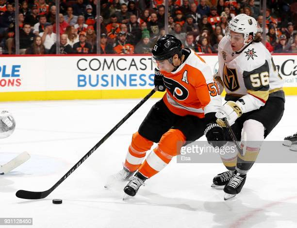 Valtteri Filppula of the Philadelphia Flyers and Erik Haula of the Vegas Golden Knights fight for the puck in the third period on March 12 2018 at...