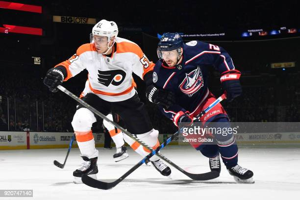 Valtteri Filppula of the Philadelphia Flyers and Oliver Bjorkstrand of the Columbus Blue Jackets chase after a loose puck on February 16 2018 at...