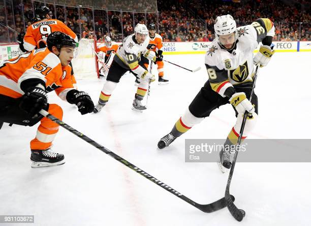 Valtteri Filppula of the Philadelphia Flyers and Tomas Hyka of the Vegas Golden Knights fight for the puck on March 12 2018 at Wells Fargo Center in...