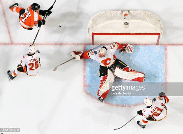 Valtteri Filppula of the Philadelphia Flyers attempts to deflect an airborne puck for a shot on goal against Michael Stone Mike Smith and Brett Kulak...