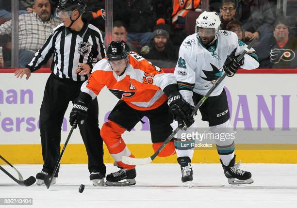 Valtteri Filppula of the Philadelphia Flyers battles for control of the puck following a faceoff against Joel Ward of the San Jose Sharks on November...