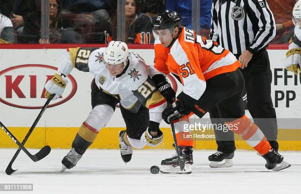 Valtteri Filppula of the Philadelphia Flyers battles for the loose puck after facing off with Cody Eakin of the Vegas Golden Knights on March 12 2018...