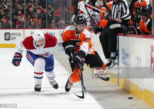 Valtteri Filppula of the Philadelphia Flyers battles for the puck along the boards against Byron Froese of the Montreal Canadiens on February 8 2018...