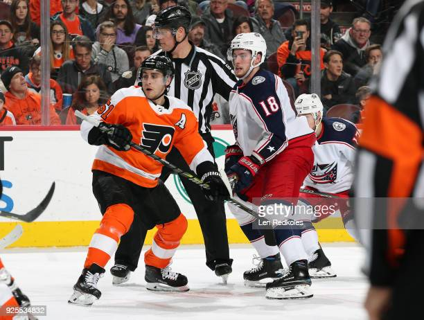 Valtteri Filppula of the Philadelphia Flyers battles on a faceoff against PierreLuc Dubois of the Columbus Blue Jackets on February 22 2018 at the...
