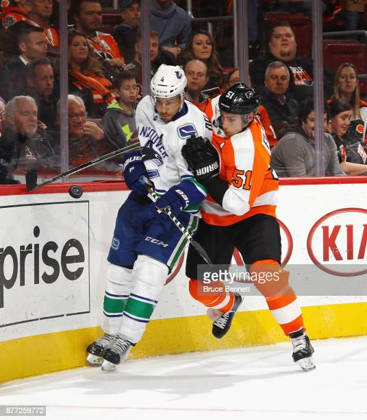 Valtteri Filppula of the Philadelphia Flyers checks Michael Del Zotto of the Vancouver Canucks along the boards during the second period at the Wells...