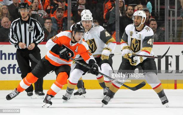 Valtteri Filppula of the Philadelphia Flyers completes a pass against Ryan Carpenter and PierreEdouard Bellemare of the Vegas Golden Knights on March...