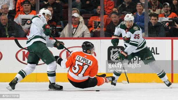 Valtteri Filppula of the Philadelphia Flyers is up ended by Joel Eriksson Ek and Jonas Brodin of the Minnesota Wild on November 11 2017 at the Wells...