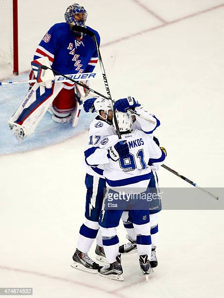 Valtteri Filppula of the Tampa Bay Lightning celebrates with his teammates after scoring a goal against Henrik Lundqvist of the New York Rangers...