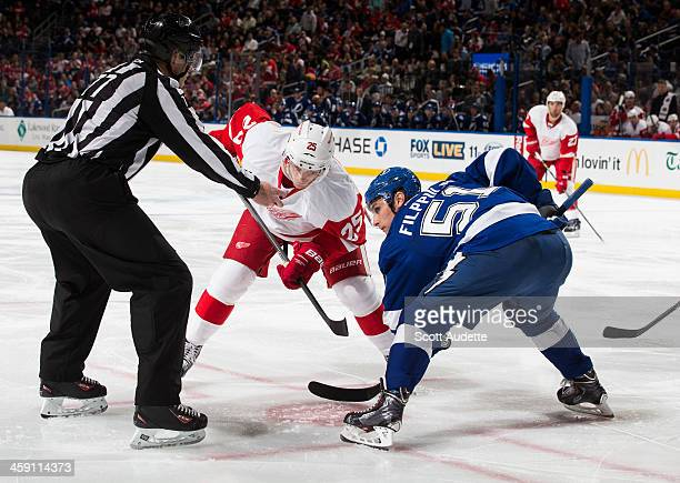 Valtteri Filppula of the Tampa Bay Lightning faces off against Cory Emmerton of the Detroit Red Wings during the second period at the Tampa Bay Times...