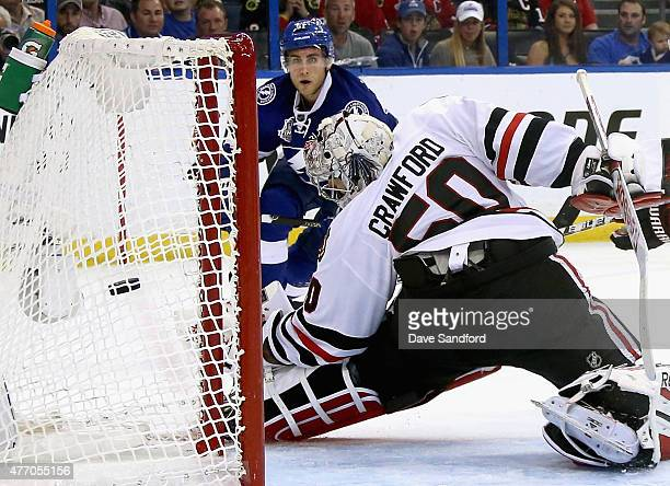 Valtteri Filppula of the Tampa Bay Lightning scores a goal on goaltender Corey Crawford of the Chicago Blackhawks during the second period of Game...