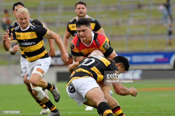 Valynce Te Whare of Waikato is tackled during the round 7 Mitre 10 Cup match between Waikato and Taranaki at FMG Stadium on October 25 2020 in...