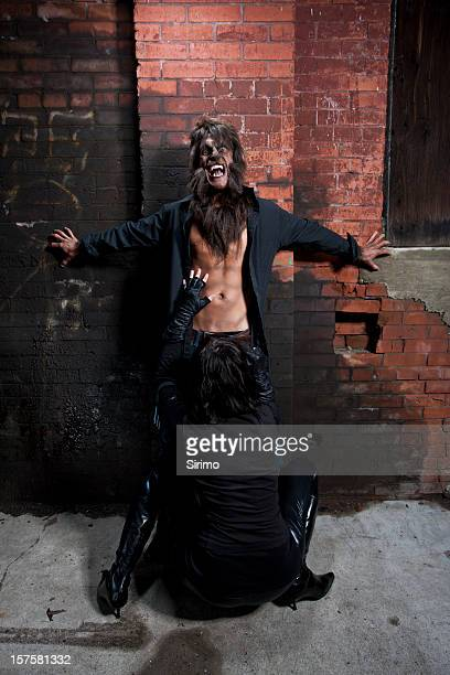 vampire blowing a werewolf - werewolf stock photos and pictures
