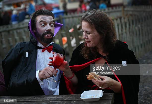 A vampire couple enjoy a drink and a burger at the Shocktober Fest at Tulleys Farm on October 5 2013 near Crawley West Sussex Each October thousands...