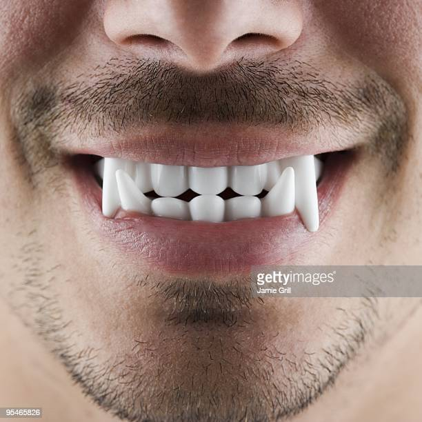 vampire fangs - vampire stock pictures, royalty-free photos & images